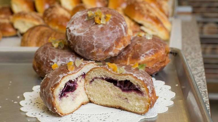 A specialty doughnut filled with blueberry marmalade imported