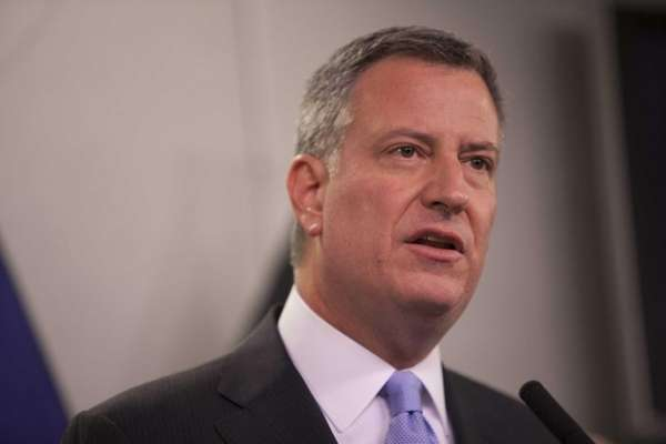 Bill de Blasio speaks at a press conference