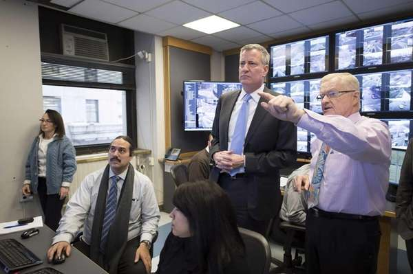 New York Mayor Bill de Blasio is briefed