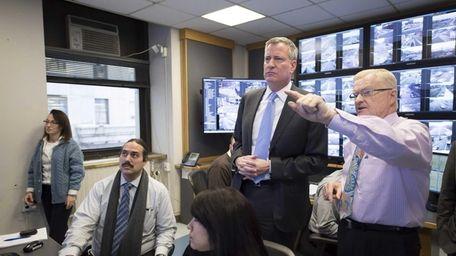 New York Mayor Bill de Blasio is briefed