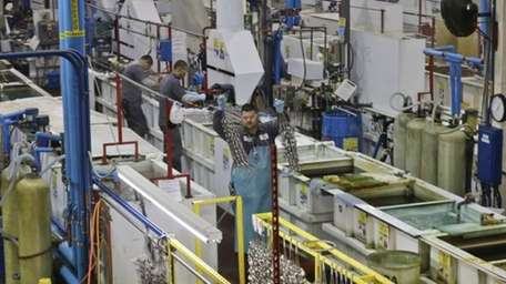 U.S. factory activity held near a 2-1/2-year high