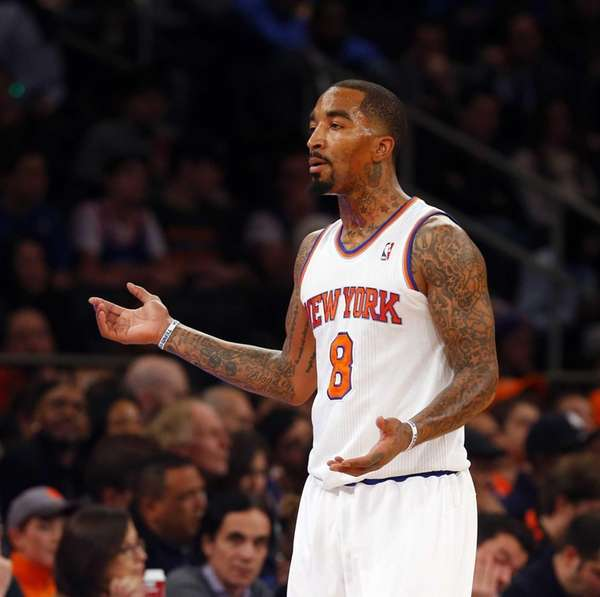 J.R. Smith looks on after a play against