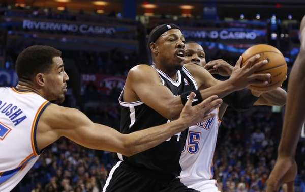Paul Pierce, center, drives between Oklahoma City Thunder