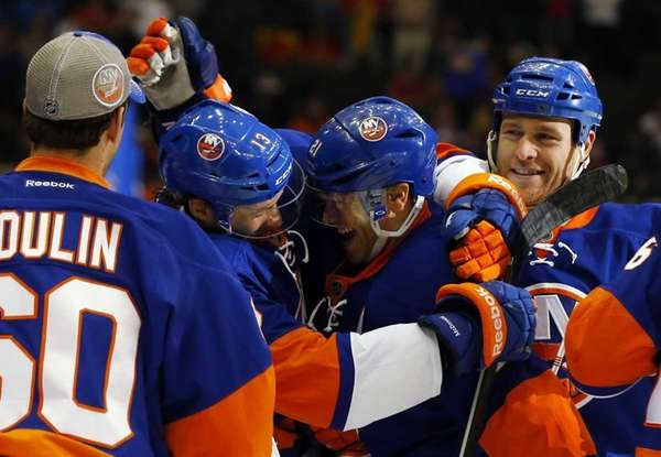 Kyle Okposo of the Islanders celebrates his overtime