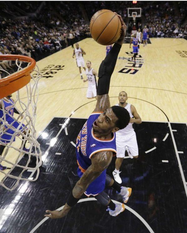Knicks' Iman Shumpert goes in for a basket