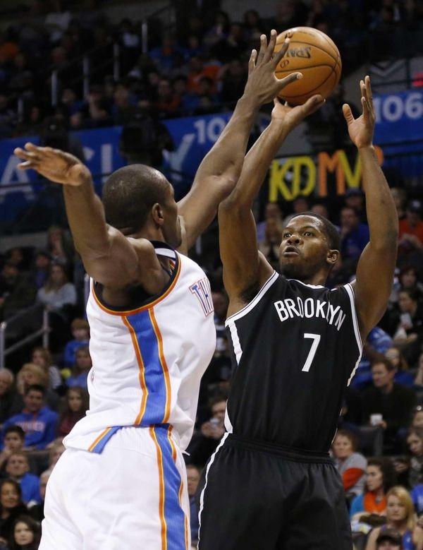 Nets guard Joe Johnson shoots as Oklahoma City