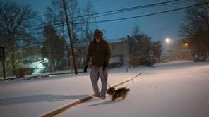 Chris Malon of Lindenhurst walks his dog on