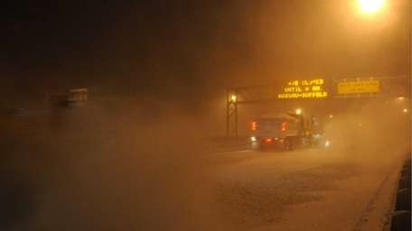 Snowplows work on clearing the eastbound LIE between