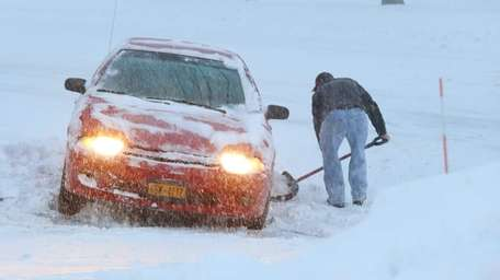 A man digs out his car in Nesconset
