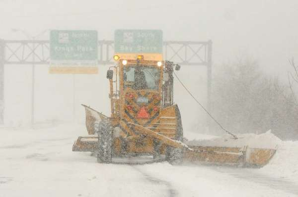 A snow removal truck moves along the eastbound