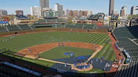 The Chicago Cubs work out at Wrigley