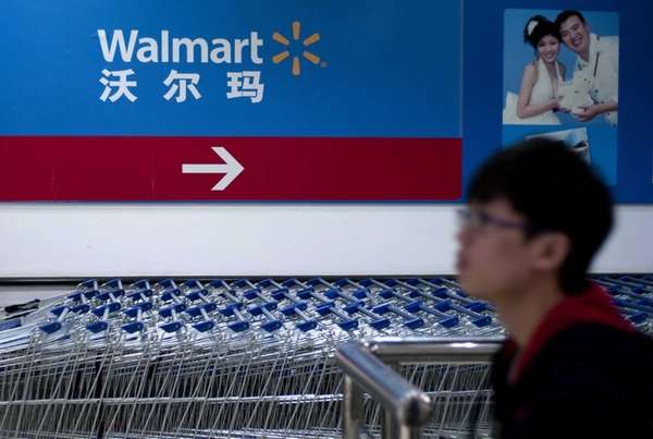 A Chinese consumer passes by in front of