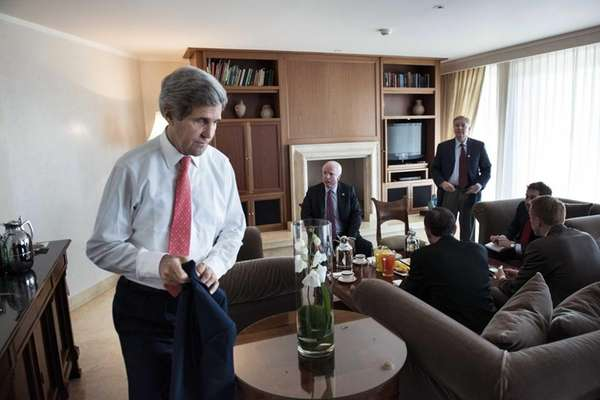 Secretary of State John Kerry, left, puts away