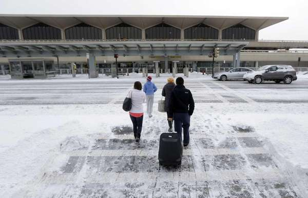 Travelers arrive at Newark Liberty International Airport in