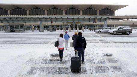 Travelers arrive at Newark Liberty International Airport in