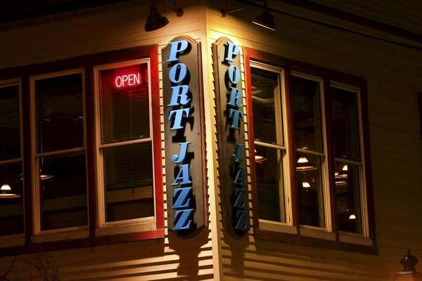 The exterior sign of Port Jazz lights up