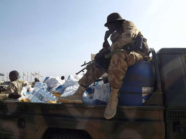 South Sudan army soldiers sit around on at