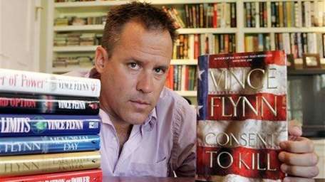 Best-selling author Vince Flynn poses with the dust