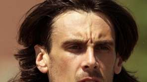 Minnesota Vikings punter Chris Kluwe attends training camp