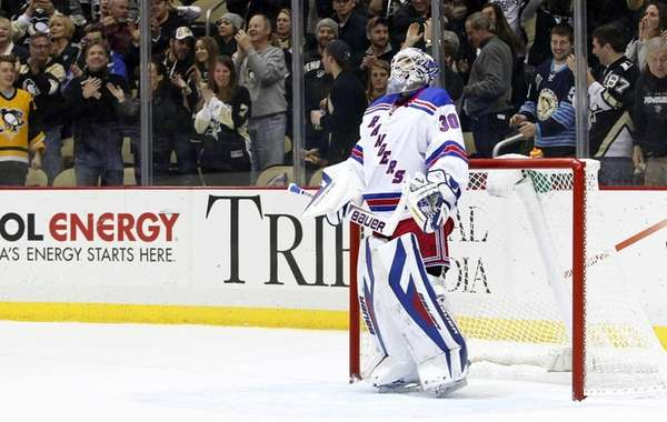 Henrik Lundqvist of the Rangers reacts after giving