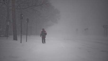 A man walks down Route 109 in West