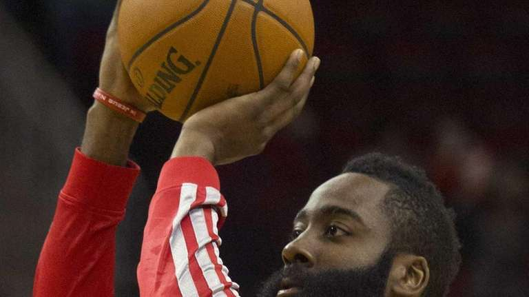 Houston Rockets guard James Harden warms up before