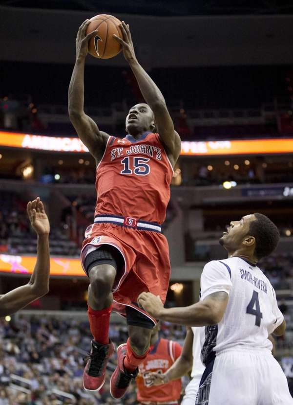 St. John's Sir'Dominic Pointer shoots as Georgetown's guard