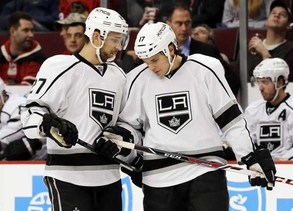 Los Angeles Kings' Alec Martinez, left, talks to