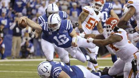 Indianapolis Colts quarterback Andrew Luck dives for a
