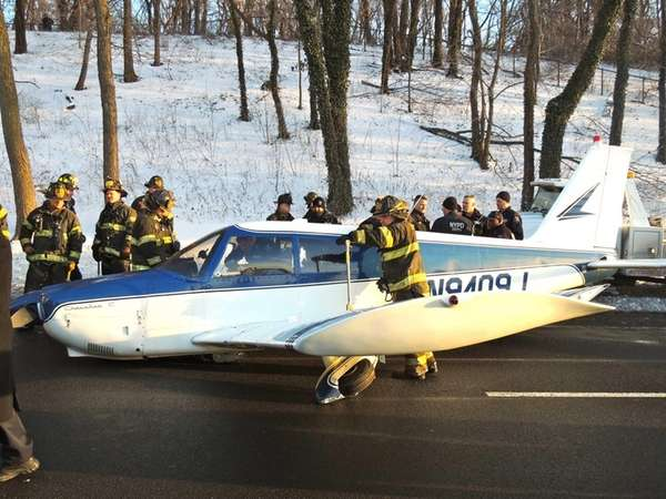 Rescue workers are seen around a small plane