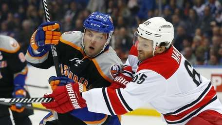 Ron Hainsey of the Carolina Hurricanes defends against