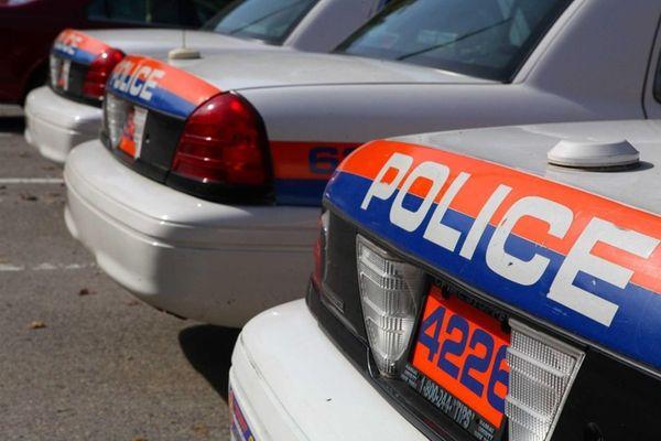 Nassau Police Cars sit outside the sixth precinct