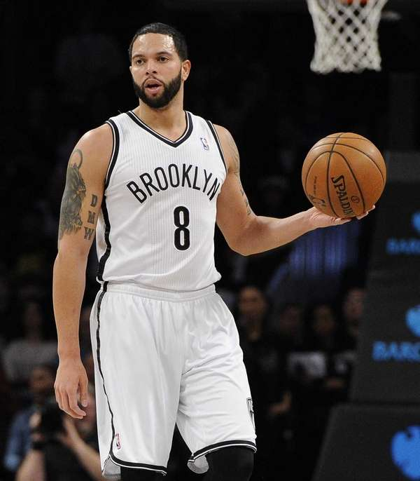 Nets guard Deron Williams controls the ball against