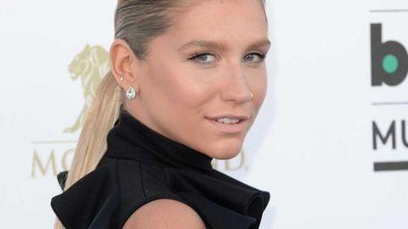 Singer Kesha arrives at the 2013 Billboard Music