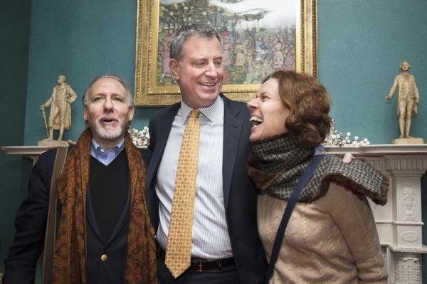 New York Mayor Bill de Blasio smiles while