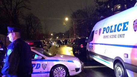 NYPD vehicles block off the area in which