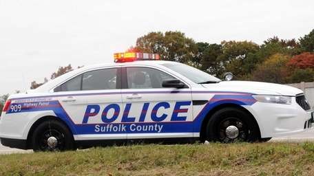 A Suffolk County police cruiser is shown pulling