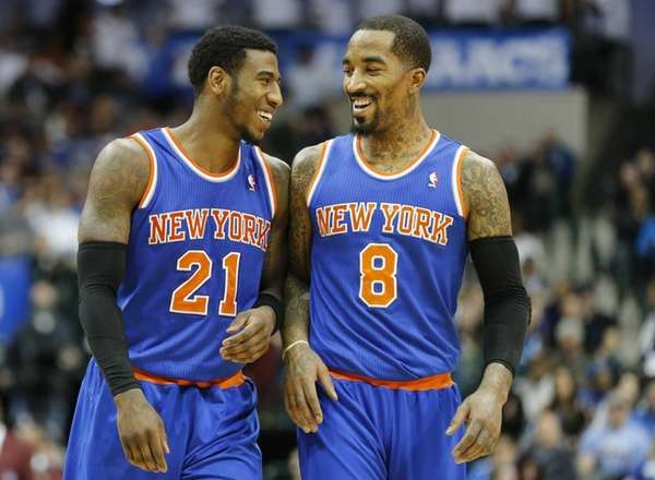 Iman Shumpert (21) and J.R. Smith (8) smile