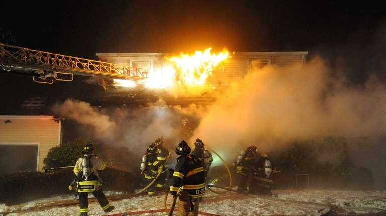 The Melville Fire Department assisted by firefighters from