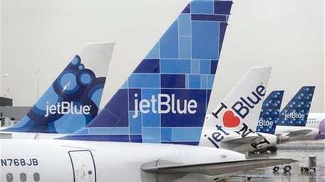 JetBlue airplanes at their gates at Kennedy Airport.