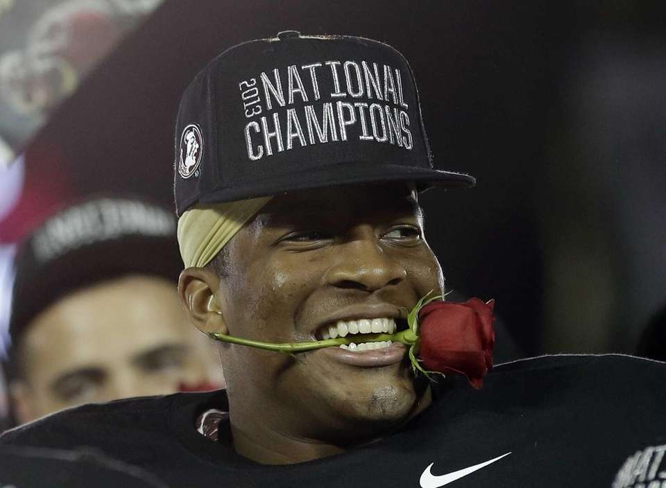 Florida State's Jameis Winston holds a rose in