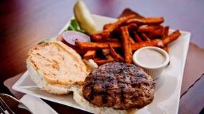 A juicy turkey burger is served with sweet