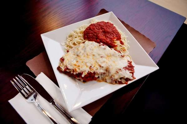 Chicken Parmigiana is tender and savory, served with
