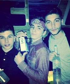 Madonna's son Rocco, center, and his friends hold