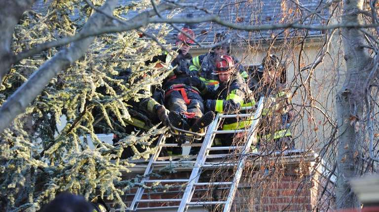 Freeport firefighters help remove an injured firefighter during