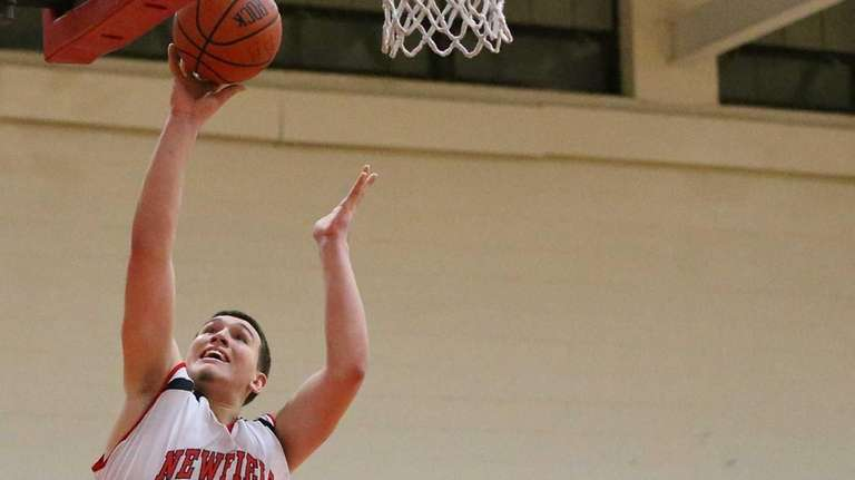 Newfield's Campbell Mastrogiacomo puts in the layup past