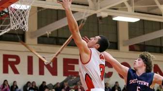 Newfield's Joseph Feliciano drives past Smithtown West's Ryan