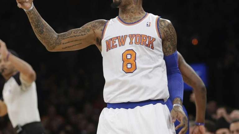 J.R. Smith (8) reacts after scoring during the