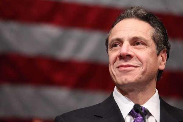 Gov. Andrew Cuomo speaks before Nassau County Executive