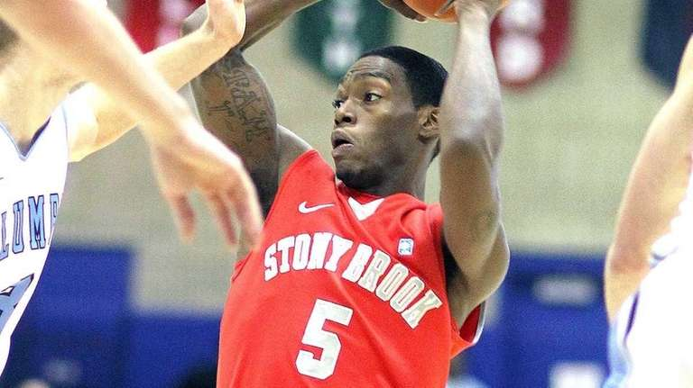 Stony Brook's Dave Coley is surrounded by Columbia